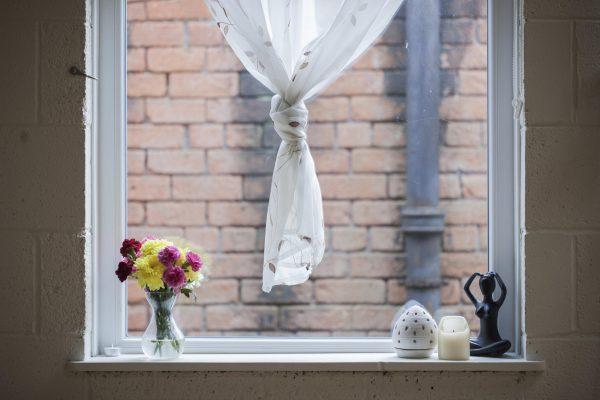 Window Flowers With Brick Wall